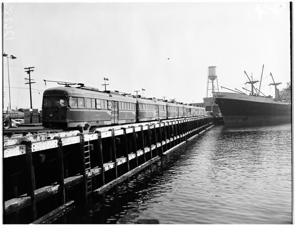 """Old street cars being loaded on ship """"Mormacland"""", 1959"""