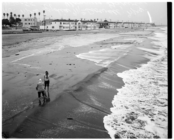 Long Beach sand eroding under pressure of high tides, 1955.