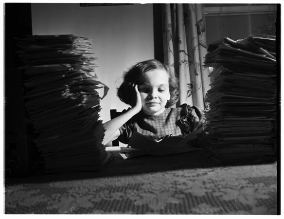 Girl receives mail from Examiner readers, 1952