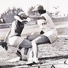 Baseball game played by sorority gals at USC's Bovard Field, 1953