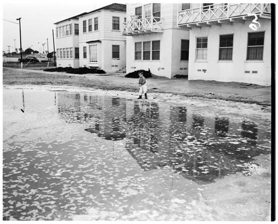 Long Beach sand eroding under pressure of high tides, 1955.