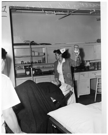 Druggist shoots bandit, 1955