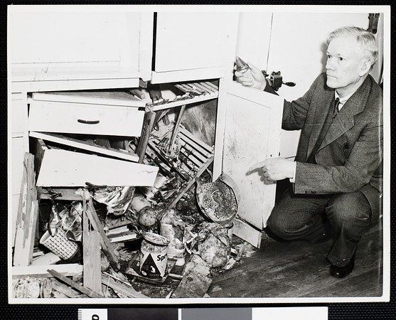Doctor's home hit by shell splinters, 1942