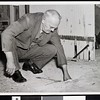 Anti-aircraft shell damages garage, 1942