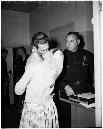 Husband and wife booked on Robbery charge, 1957
