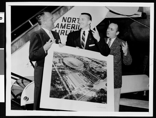 Harold Voegelin, David Holt and Dick Fitzgerald holding architects drawing for the planned new Sports Arena, 1956