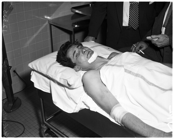 Auto theft suspect shot by officer, 1958