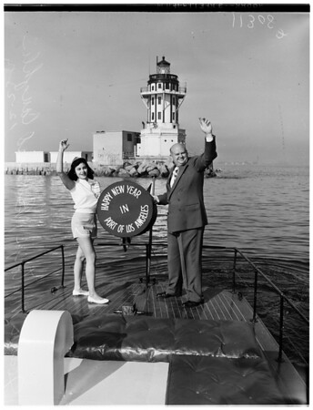 """Happy Holidays"" signal hung on the Los Angeles Harbor Lighthouse welcoming ships to Los Angeles Harbor, 1954"