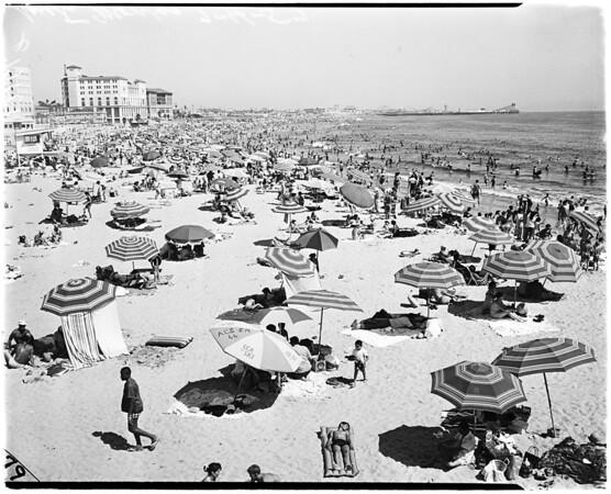 Weather negatives: general views of crowd at Santa Monica beach, 1958