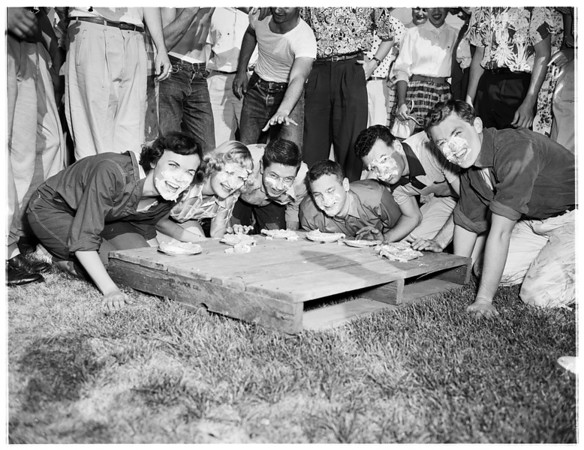 University of Southern California Soph-Frosh brawl -- Pie eating contest, 1953