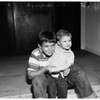 Boy rescued his brother from home fire (Long Beach), 1958