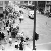 Crowds cross at 7th Street and Broadway, 1956