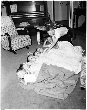 Rescued from fire in their home, 1958