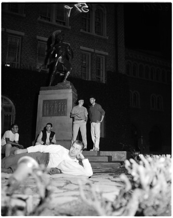 """Guarding """"Tommy Trojan"""" before football game, 1959"""