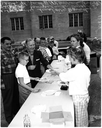 Debs served hotcakes at Highland Park YMCA Community Center breakfast, 1958