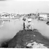 Flood waters surround homes, 1958
