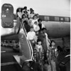 Korean orphans with foster parents arrive on United from San Francisco, 1958