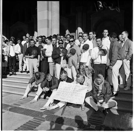 University of Southern California students caught at University of California Los Angeles trying to hoist USC banner on UCLA flag pole, 1961