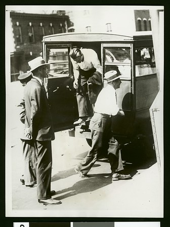 """Members of the rum yacht """"Allegro"""" as they arrived for the official hearing, 1931"""