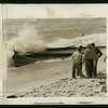 Coast Guardsmen put out fire set to a rum-running boat by its crew, 1933