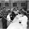Debs served hotcakes at Highland Park YMCA Community Center breakfast, 1958