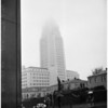 View from Hall of Justice showing City Hall tower buried in low rain clowds, 1956