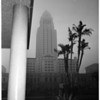 City Hall almost obscured by early morning fog as seen from new police building, 1956