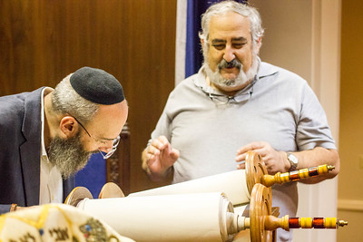 Checking the Torah Scroll for any issues... The scroll was perfect!