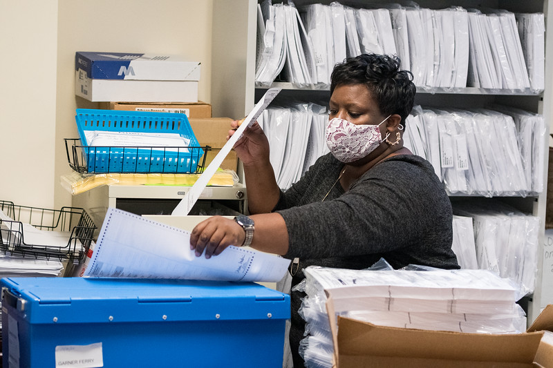 Election workers sort absentee ballot envelopes at the Richland County Administration Building in the election commission office in Columbia on Wednesday, November 4. John A. Carlos II / Special to The Post and Courier