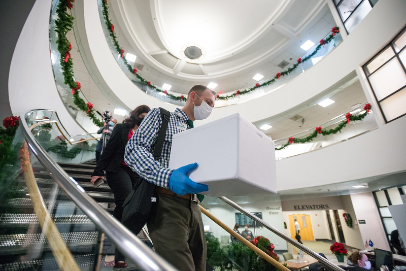 Lexington Medical Center Pharmacist Lee Stabler delivers 2,925 doses of the Pfizer-BioNTech vaccine to employees getting the shot at Lexington Medical Park 1 on Tue. Dec. 15. John A. Carlos II / Special to The Post and Courier