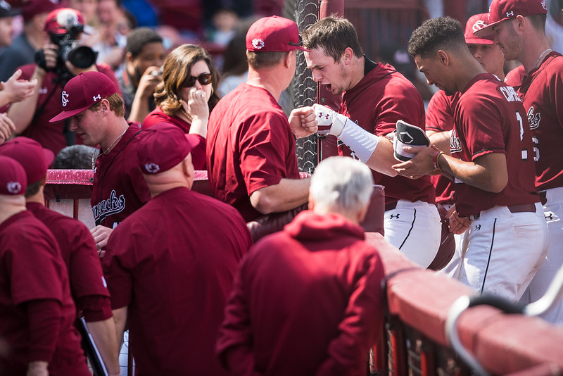 Luke Berryhill celebrates a home run with South Carolina Head Coach Mark Kingston, at Founders Park on March 3, 2019. John A. Carlos II / Special to The Post and Courier