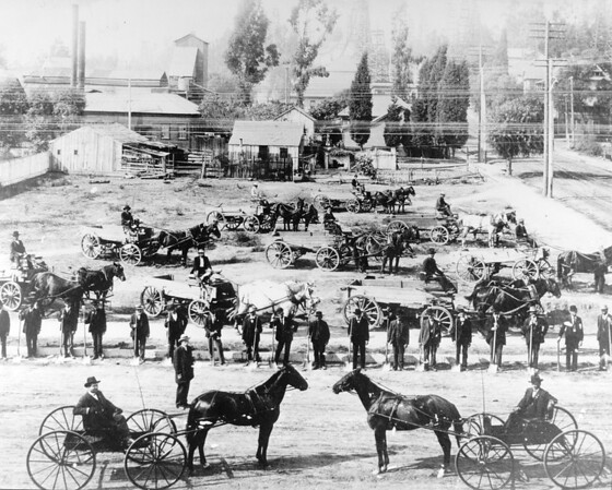 Horse-drawn wagons and men with shovels, Los Angeles, ca. early 1900s
