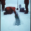 Researchers digging a trench to study microbes living in ice fissures in the Antarctic, 1999