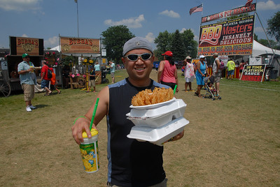 Ribfest - Naperville, Illinois - July 3-7, 2013 - Fine dining at Ribfest !!!    Just look at the smiles !!!