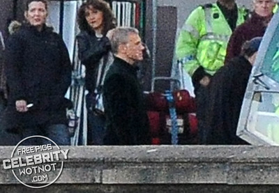 EXC: Bond Villain Christoph Waltz/Blofeld Shows Off Facial Scars Filming Helicopter Scene For SPECTRE