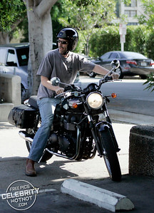 EXC: Hugh Laurie Takes His Triumph Motobike For A Spin