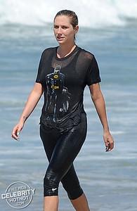 EXCLUSIVE: Kesha Goes Body Surfing In Vintage Batman Tee On Santa Monica Beach, LA
