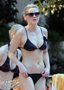 EXCLUSIVE: Kirsten Dunst Shows Off Her Trim Figure In A Black Bikini