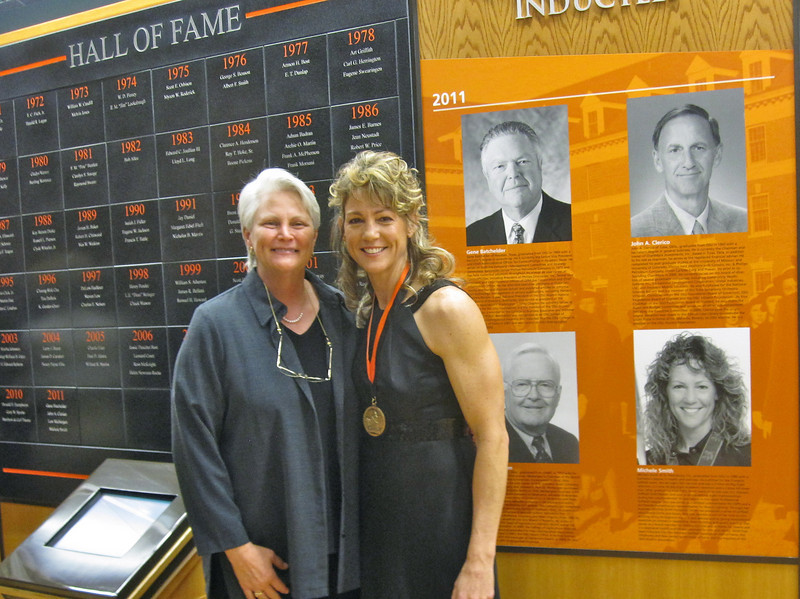 Michele's former OSU Softball Coach Sandy Fischer joins Michele at the OSU Alumni Hall of Fame Induction Ceremony held in Still Water, OK.