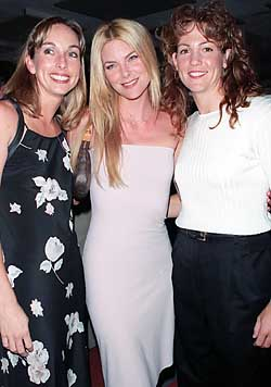 06/19/00.    United States softball team members (L), Leah O'Brian-Amico, (R) Michele Smith, (C) Party of Five star, Paula Devic, at the Nike unvailing of the uniforms that will be worn at the Summer Olyimpics at the UN.