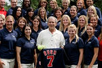 President Bush, center, poses for photographs with the University of Arizona 2007 NCAA national softball champions, Wednesday, June 27, 2007, in the Rose Garden of the White House in Washington.  (AP Photo/Evan Vucci)