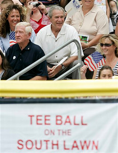 President Bush, center, watches a tee ball game on the South Lawn of the White House in Washington, Wednesday, June 27, 2007.  (AP Photo/Evan Vucci)