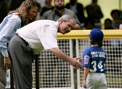 President Bush, second from left, and two-time Olympic gold medalist Michele Smith, left, greet a tee ball player after a tee ball game on the South Lawn of the White House in Washington, Wednesday, June 27, 2007.  (AP Photo/Evan Vucci)