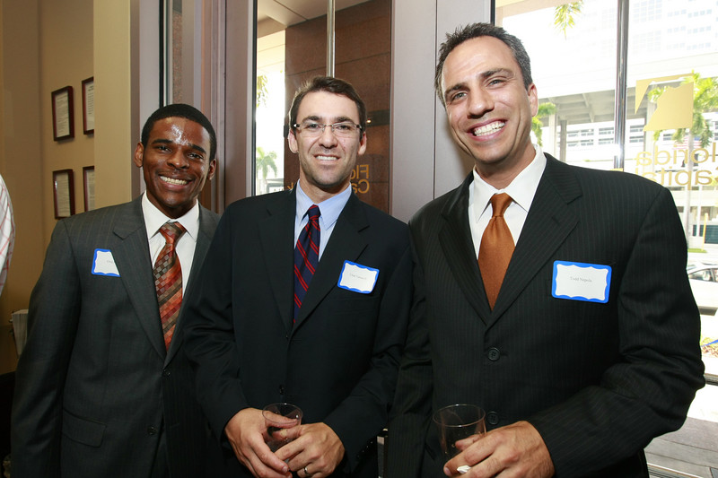 Greg Beck, Chad Taroff and Todd Nepola are showing their pearly whites as they are enjoying the evenings celebration