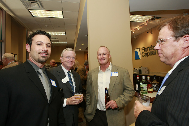 Second from left, President and CEO of Florida Capital Group, Charles Hughes visits with South Florida Board Member Greg Burie and Florida Capital Group CFO, Steve Morrill