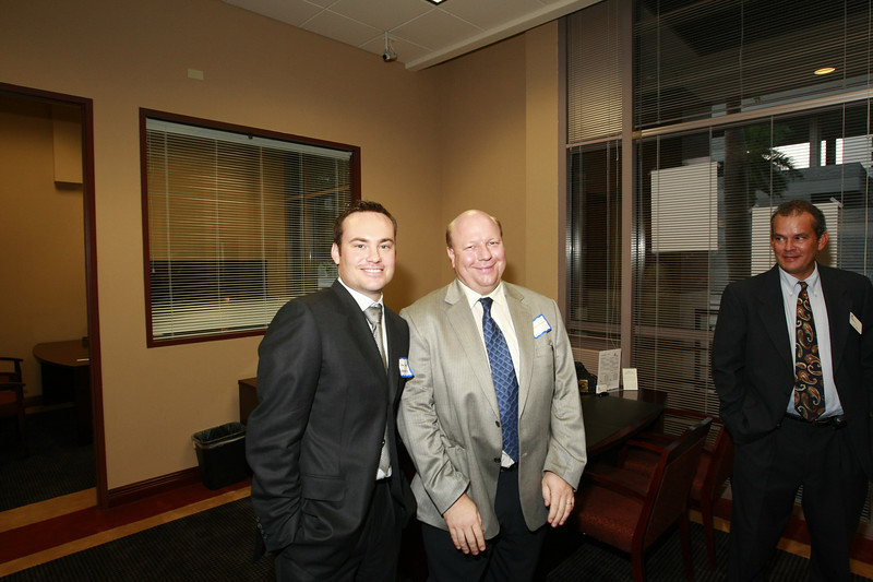 Jason Throne of Edgar Benes Law firm, local Board Member Volkmar Dirksen enjoy the Ft Lauderdale Grand Opening while Boca RM, Len Halley tries to step out of the picture.