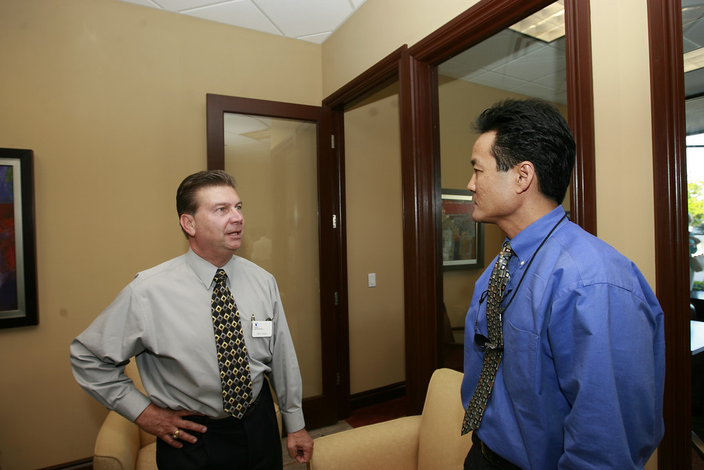Mike Staley, Market Executive for Florida Capital Bank (left) chats with Richard Sun, local Architect.