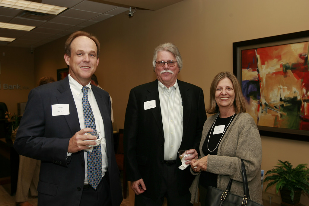 From left to right: David Norris, Jon Klein and Rebel Cook enjoy themselves at North Palm Beach's Grand Opening