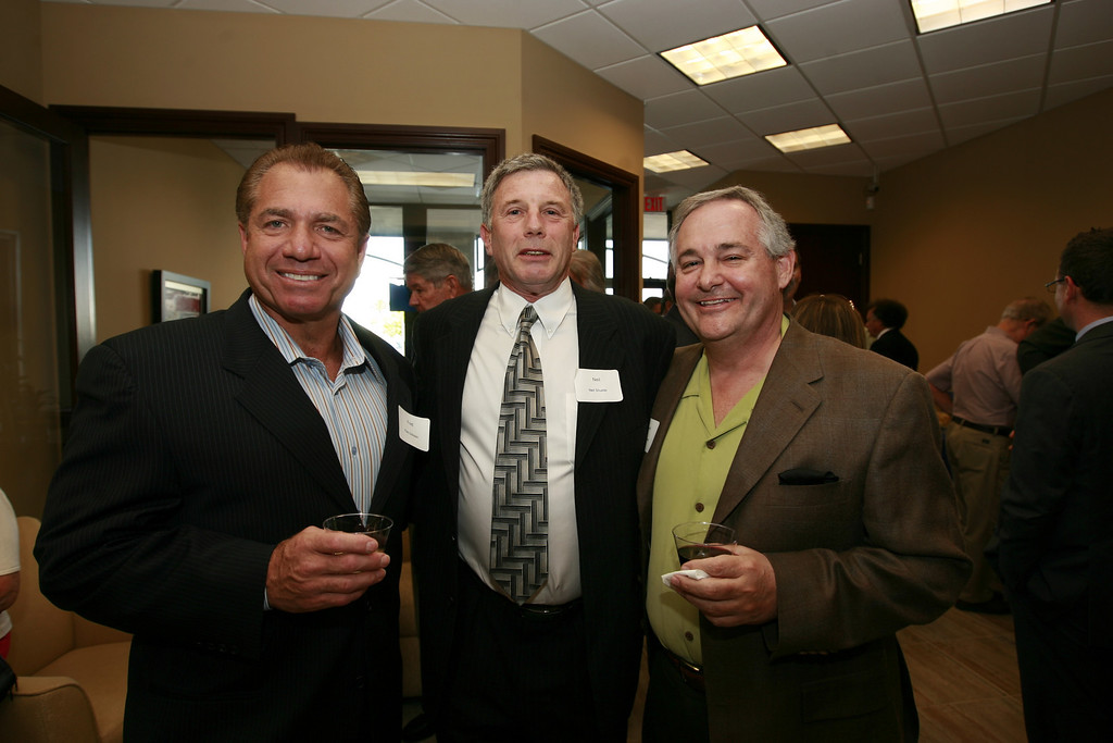 Fred Dickstein and Neil Shuster officials with CardService International, and Robert Russo, Regional Director for First Data.