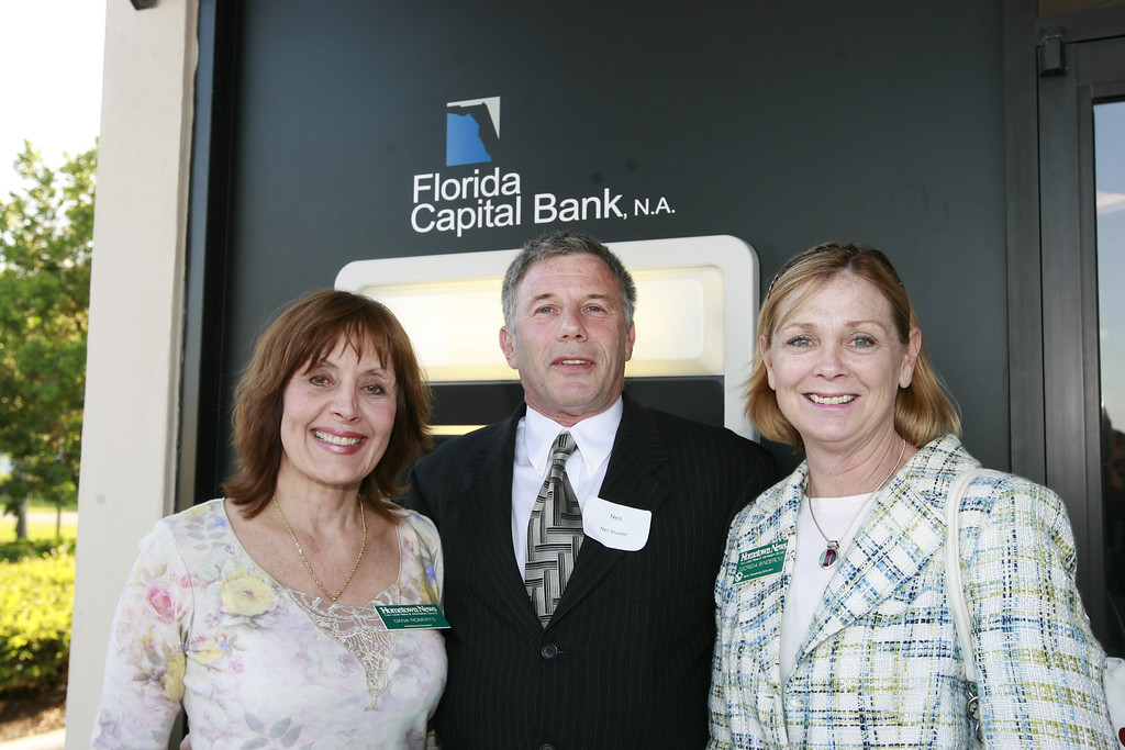 Dana Roberts (left), and Georgia Binderow, of Hometown News (right), Join Neil Shuster, (center) Cardservce Inenational.